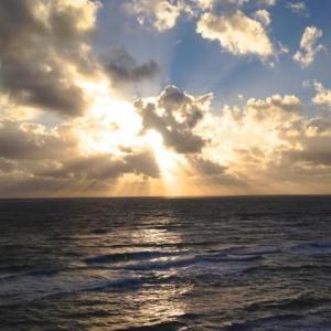 Sunburst clouds over ocean